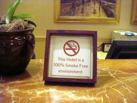 L A Smoke Free Hotel Sign Board At The Reception Desk Of Boston Marriott Copley Place R Pole Style Cigarette Receptor Is Placed Far From